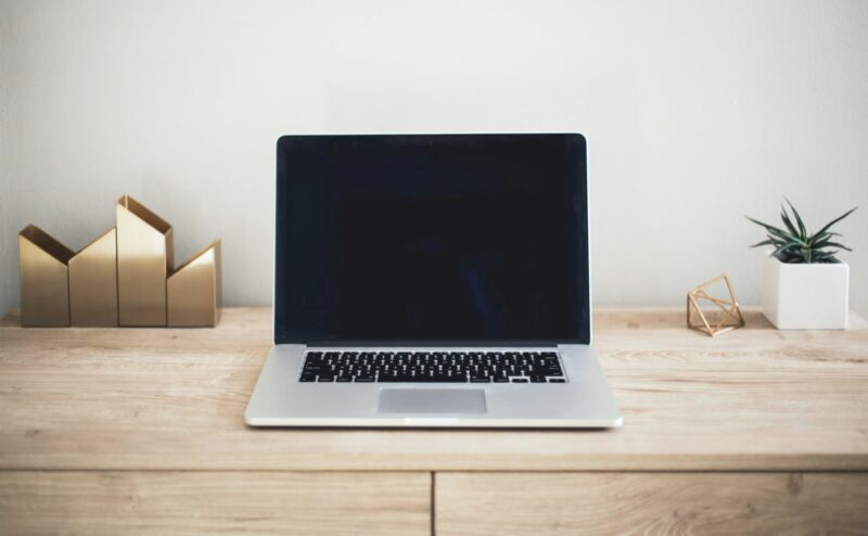 Buying a computer? An image of a new computer sits on a desk in an office space.