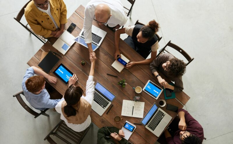 A team of IT Managed Services experts meet with a business owner.